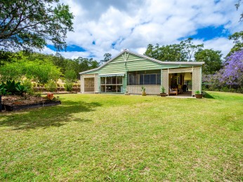 4 BEDROOM HOME WITH RETREAT, LARGE SHED ON 39.5 ACRES
