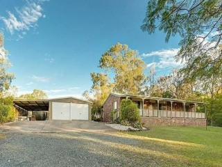 Horse Friendly 8 Acres with 4 Bay Shed and Solid Brick Home